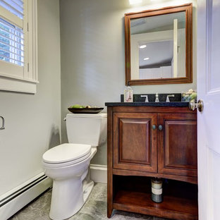 Bathroom - small craftsman 3/4 porcelain tile bathroom idea in Providence with an undermount sink, raised-panel cabinets, medium tone wood cabinets, granite countertops, a two-piece toilet and gray walls