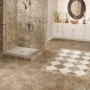 Corner shower - mid-sized mediterranean master white tile and ceramic tile travertine floor and brown floor corner shower idea in Other with recessed-panel cabinets, white cabinets, gray walls, a vessel sink, tile countertops and a hinged shower door