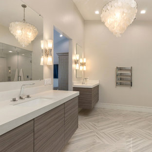 Inspiration for a mid-sized contemporary master white tile and porcelain tile porcelain tile and white floor bathroom remodel in Orange County with flat-panel cabinets, medium tone wood cabinets, a one-piece toilet, white walls, an undermount sink, quartz countertops and a hinged shower door