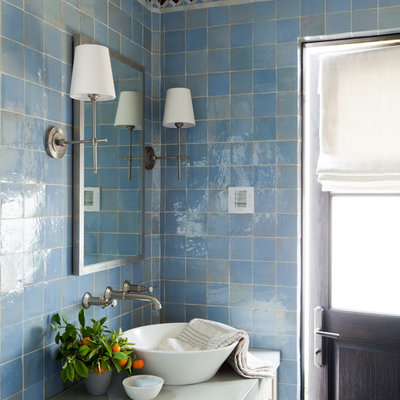 Tuscan blue tile bathroom photo in Orange County with a vessel sink