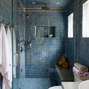 Example of a tuscan blue tile alcove shower design in Orange County