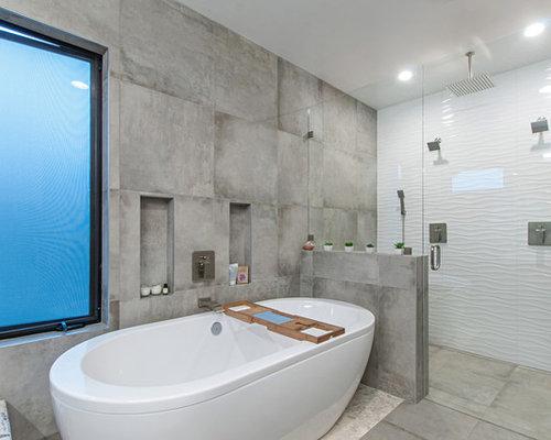 Bagno con pavimento con cementine e piastrelle grigie foto idee