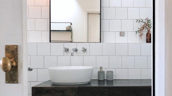 Monochrome bathroom, sleek and modern warmed by real wood, natural touches and a