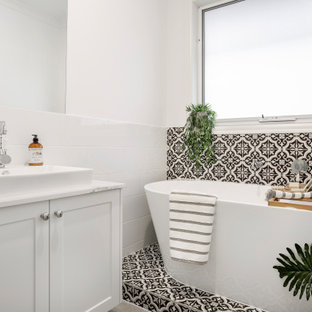 Transitional 3/4 bathroom in Melbourne with shaker cabinets, white cabinets, a freestanding tub, black and white tile, gray tile, white walls, a vessel sink, marble benchtops, multi-coloured floor, multi-coloured benchtops, a single vanity, a built-in vanity and ceramic tile.