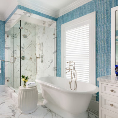 Bathroom - tropical master multicolored tile marble floor and multicolored floor bathroom idea in Miami with recessed-panel cabinets, white cabinets, multicolored walls, a hinged shower door and multicolored countertops