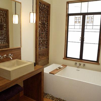 Freestanding bathtub - contemporary freestanding bathtub idea in San Francisco with a vessel sink