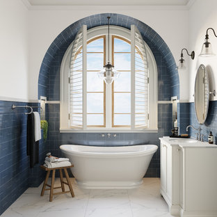Traditional bathroom in Melbourne with white cabinets, a freestanding tub, blue tile, white walls, an undermount sink, white floor and white benchtops.
