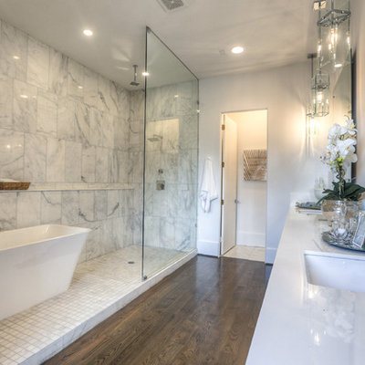 Large transitional master white tile and marble tile dark wood floor and brown floor bathroom photo in Houston with an undermount sink, furniture-like cabinets, a two-piece toilet, white walls, quartz countertops and white countertops