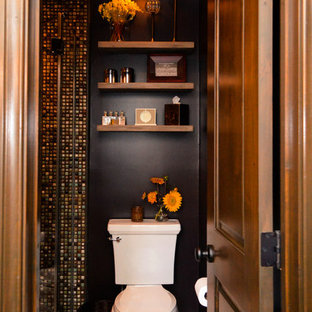 Design ideas for a small mediterranean shower room in Los Angeles with open cabinets, medium wood cabinets, a corner shower, a two-piece toilet, multi-coloured tiles, ceramic tiles, brown walls, porcelain flooring, a vessel sink, beige floors and a hinged door.