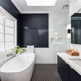 Inspiration for a mid-sized transitional master bathroom in Brisbane with flat-panel cabinets, blue cabinets, a freestanding tub, an alcove shower, subway tile, blue walls, porcelain floors, an undermount sink, engineered quartz benchtops, an open shower, white benchtops, white tile and multi-coloured floor.