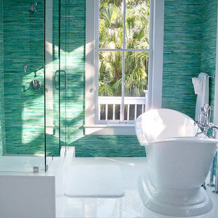 Inspiration for a mid-sized tropical bathroom in New York with a freestanding tub, a corner shower and blue walls.