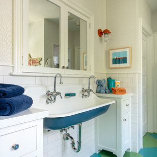Farmhouse kids' white tile and ceramic tile painted wood floor and multicolored floor bathroom photo in Los Angeles with shaker cabinets, white cabinets, quartz countertops, white countertops, white walls and a wall-mount sink