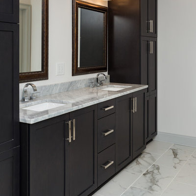 Inspiration for a mid-sized transitional master gray tile and porcelain tile marble floor bathroom remodel in Atlanta with shaker cabinets, dark wood cabinets, a one-piece toilet, white walls, an undermount sink and granite countertops
