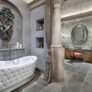 Ispirazione per un'ampia stanza da bagno padronale mediterranea con ante con riquadro incassato, ante in legno chiaro, vasca freestanding, piastrelle multicolore, piastrelle a mosaico, pareti multicolore, top in granito, top verde, pavimento in marmo e pavimento marrone
