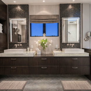 Large trendy master multicolored tile and porcelain tile porcelain tile bathroom photo in San Francisco with a vessel sink, flat-panel cabinets, dark wood cabinets, marble countertops, a one-piece toilet and beige walls