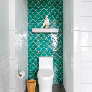 Large beach style master green tile and porcelain tile porcelain floor and gray floor toilet room photo in Seattle with a one-piece toilet and white walls