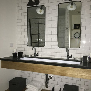 Mid-sized urban master white tile and subway tile doorless shower photo in Los Angeles with open cabinets, white walls, a trough sink and solid surface countertops