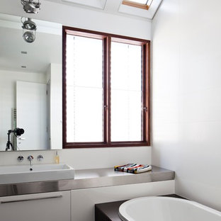 Photo of a large contemporary kids bathroom in Sydney with flat-panel cabinets, white cabinets, white tile, porcelain tile, stainless steel benchtops and grey benchtops.