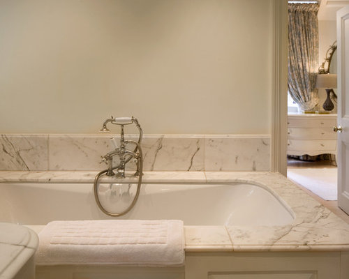 Traditional Bathroom Idea In London With A Drop In Tub And White Tile