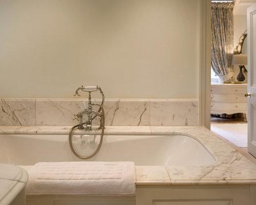 traditional white tile dropin bathtub idea in london