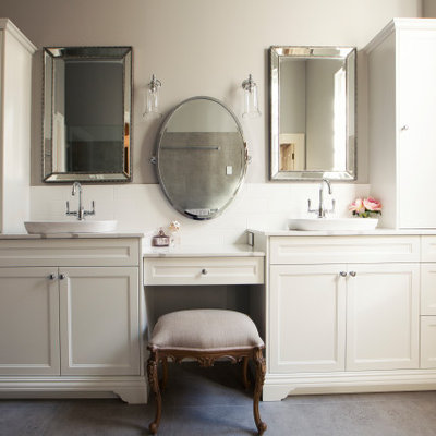 Example of a mid-sized classic 3/4 white tile and ceramic tile ceramic tile and gray floor bathroom design in Perth with furniture-like cabinets, white cabinets, a two-piece toilet, gray walls, a vessel sink and white countertops