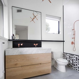 Mid-sized trendy master white tile and porcelain tile gray floor bathroom photo in Los Angeles with flat-panel cabinets, light wood cabinets, marble countertops, gray countertops, a two-piece toilet, white walls and a trough sink