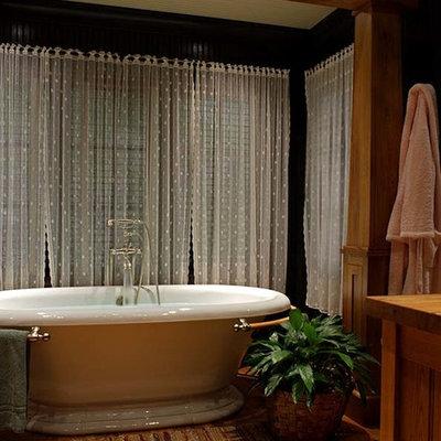 Freestanding bathtub - rustic master medium tone wood floor freestanding bathtub idea in Other