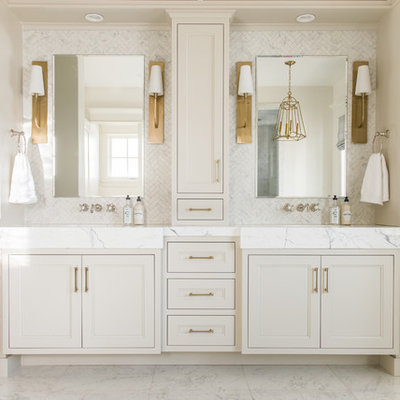 Example of a mid-sized classic master white tile and marble tile white floor and marble floor bathroom design in Salt Lake City with recessed-panel cabinets, beige cabinets, white walls, white countertops, an integrated sink and marble countertops