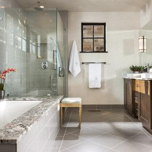 Inspiration för rustika en-suite badrum, med ett fristående handfat, luckor med infälld panel, skåp i mörkt trä, marmorbänkskiva, ett undermonterat badkar, en kantlös dusch, grå kakel, vita väggar och klinkergolv i porslin