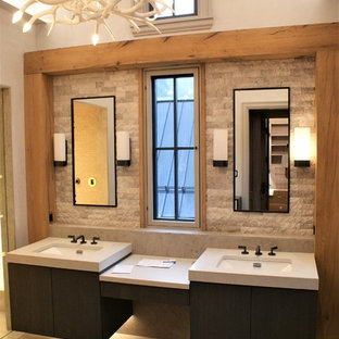 Inspiration for a mid-sized modern master porcelain tile bathroom remodel in Denver with flat-panel cabinets, dark wood cabinets, an undermount sink and beige walls