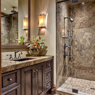 Alcove shower - rustic brown tile brown floor alcove shower idea in Other with an undermount sink, raised-panel cabinets, dark wood cabinets and brown countertops