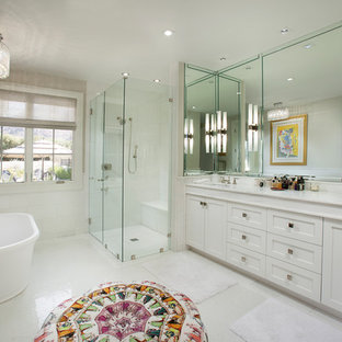 Example of a transitional white tile bathroom design in Los Angeles with an undermount sink, shaker cabinets, white cabinets and beige walls