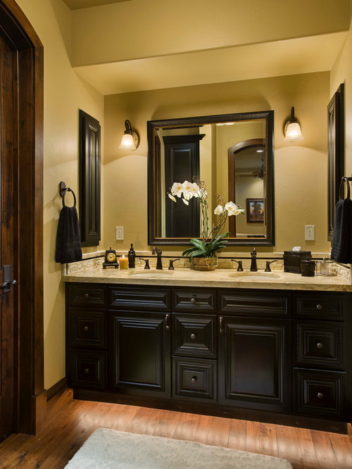 inspiration for a rustic bathroom remodel in other with black cabinets and yellow walls - Bathroom Ideas Brown
