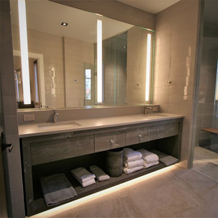 Mid-sized trendy master gray tile ceramic tile and gray floor walk-in shower photo in Other with open cabinets, gray cabinets, an undermount sink, concrete countertops and a hinged shower door