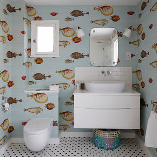 Inspiration for a mid-sized eclectic kids' white tile and subway tile ceramic floor bathroom remodel in London with flat-panel cabinets, white cabinets, quartzite countertops, multicolored walls, a vessel sink and a one-piece toilet