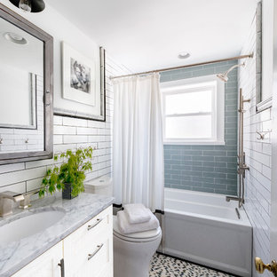 Inspiration for a timeless blue tile and subway tile mosaic tile floor bathroom remodel in Philadelphia with an undermount sink, recessed-panel cabinets, white cabinets and gray countertops