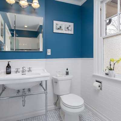 Mid-sized elegant 3/4 white tile and subway tile white floor alcove shower photo in Philadelphia with blue walls, a two-piece toilet, a wall-mount sink and a hinged shower door