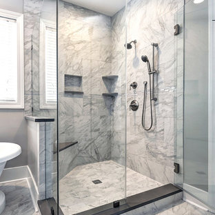 Example of a mid-sized trendy master gray tile and porcelain tile porcelain tile and gray floor bathroom design in Charleston with shaker cabinets, gray cabinets, gray walls, an undermount sink, quartz countertops and a hinged shower door