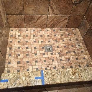 Esempio di una stanza da bagno con doccia tradizionale di medie dimensioni con ante con bugna sagomata, ante in legno chiaro, doccia alcova, piastrelle marroni, piastrelle in gres porcellanato, pareti rosse, pavimento in gres porcellanato, lavabo sottopiano e top in granito
