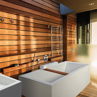 Inspiration for a large asian master bathroom in Other with a freestanding tub, medium hardwood floors and a vessel sink.