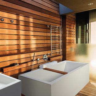 Large zen master medium tone wood floor freestanding bathtub photo in Other with a vessel sink