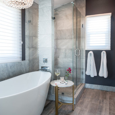 Inspiration for a mid-sized transitional master gray tile and marble tile porcelain tile and gray floor bathroom remodel in Denver with a hinged shower door, black walls, marble countertops and gray countertops