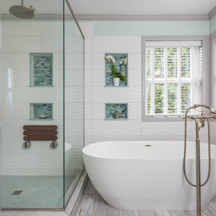 Example of a large transitional master white tile and glass tile porcelain floor and gray floor bathroom design in Seattle with turquoise cabinets, a vessel sink, engineered quartz countertops, a hinged shower door, white walls and recessed-panel cabinets