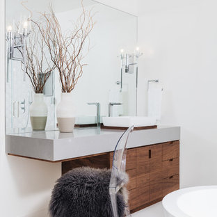 Example of a trendy master white floor bathroom design in Los Angeles with flat-panel cabinets, dark wood cabinets, white walls, a vessel sink and gray countertops