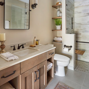 Small arts and crafts 3/4 multicolored tile and porcelain tile porcelain tile and gray floor alcove shower photo in Chicago with shaker cabinets, light wood cabinets, a two-piece toilet, beige walls, an undermount sink, quartz countertops, a hinged shower door and gray countertops