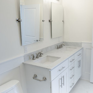 Inspiration for a large transitional master white tile and marble tile porcelain tile and white floor bathroom remodel in New York with shaker cabinets, a one-piece toilet, white walls, a console sink, quartz countertops and white cabinets