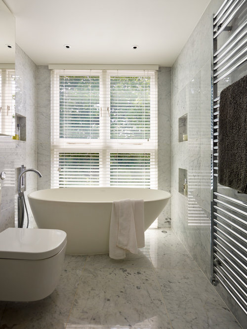 inspiration for a gray tile and marble tile marble floor bathtub remodel in london