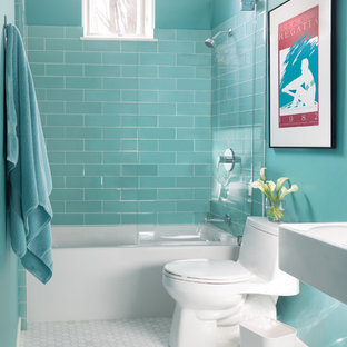 Mid-sized transitional bathroom in Boston with a shower/bathtub combo, glass tile, marble floors, a wall-mount sink, an alcove tub, a one-piece toilet, blue tile, white floor, an open shower and blue walls.