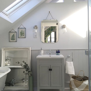Small classic bathroom in Other with a claw-foot bath, white walls, marble flooring, a submerged sink and grey floors.