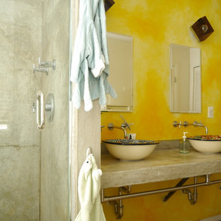 Mid-sized eclectic master terra-cotta tile concrete floor bathroom photo in New York with a vessel sink, concrete countertops and yellow walls